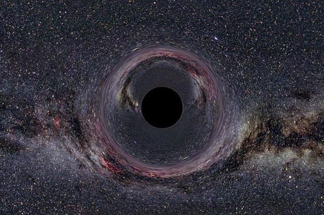 Così apparirebbe probabilmente un buco nero posto in un contesto particlarmente ricco di stelle