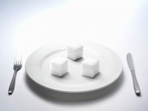 Sugar placed on white dish