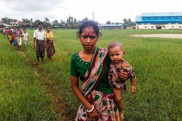Rohingya in fuga dal Myanmar al Bangladesh @Getty Images).