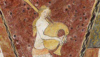 Musée de l'Oise, Beauvais: una sirena intenta a suonare uno strumento molto simile alla zampogna (XIV secolo).