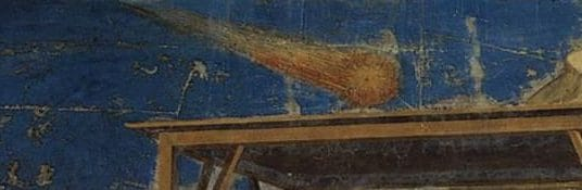 Il particolare della stella cometa nell'Adorazione dei Magi di Giotto. Secondo alcuni si tratterebbe della cometa di Halley.