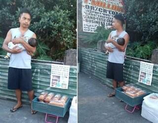 """Filippine, vende dolci in strada col figlio neonato: """"Il bimbo è malato, servono soldi per le cure"""""""