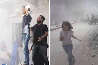 Le mani sul capo di un padre che ha perso tre figli, l'ennesimo volto del dolore della Siria