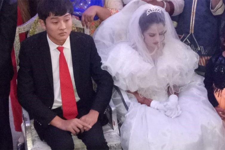 Le nozze tra un giovane cinese e una ragazza pakistana (Voa)