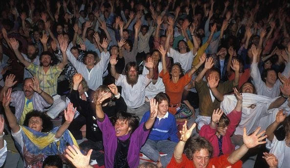 Alcuni discepoli di Osho in un raduno, a Pune, nel 1988.
