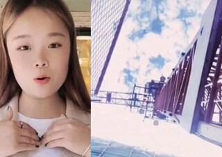 Star di Tik Tok muore in diretta a 23 anni: cade da una gru per 43 metri mentre registra un video