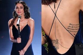Anna Tatangelo a Sanremo con la schiena nuda rivela il tatuaggio, ecco il suo significato