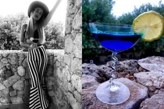 Clizia Incorvaia con maxi cappello e pantaloni a righe, rivela la ricetta del suo nuovo drink
