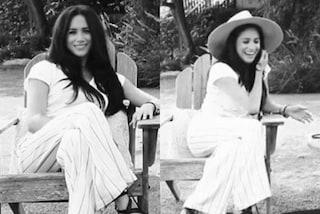 Meghan Markle in bianco e col cappello paglia: il look perfetto per l'estate vale più di 8mila euro