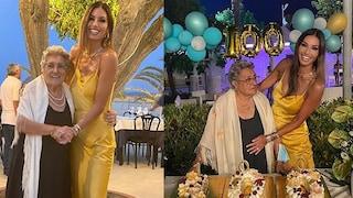 Elisabetta Gregoraci festeggia i 100 anni della nonna: brilla con l'abito sottoveste oro