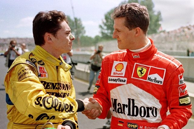 Giancarlo Fisichella e Michael Schumacher – Getty images