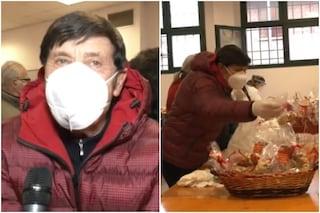 Gianni Morandi distribuisce il pranzo di Natale ai bisognosi