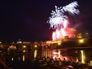 A general view shows fireworks over the Tiber river and the Castel Sant'Angelo (St Angel castle) during the traditional 'Girandola' the feast of Romes patron St Peter and Paul, on June 29, 2014 in Rome. AFP PHOTO / TIZIANA FABI (Photo credit should read TIZIANA FABI/AFP/Getty Images)