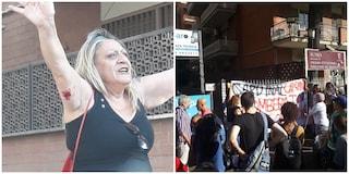 Tensione tra senza casa e polizia fuori un palazzo vuoto: tafferugli, una donna ferita