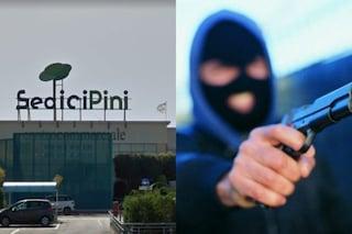 Pomezia, paura al centro commerciale: uomo armato di fucile rapina il supermercato Coop