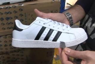 Roma, maxi sequestro di scarpe false Adidas e Nike: otto arresti
