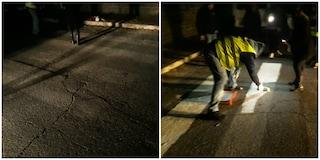 """San Basilio, abitanti si dipingono da soli strisce pedonali scomparse: """"Abbandonati da istituzioni"""""""