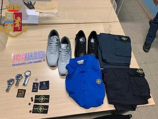 Scarpe, pantaloni, t-shirt e orologi Rolex falsi: denunciato un venditore ambulante