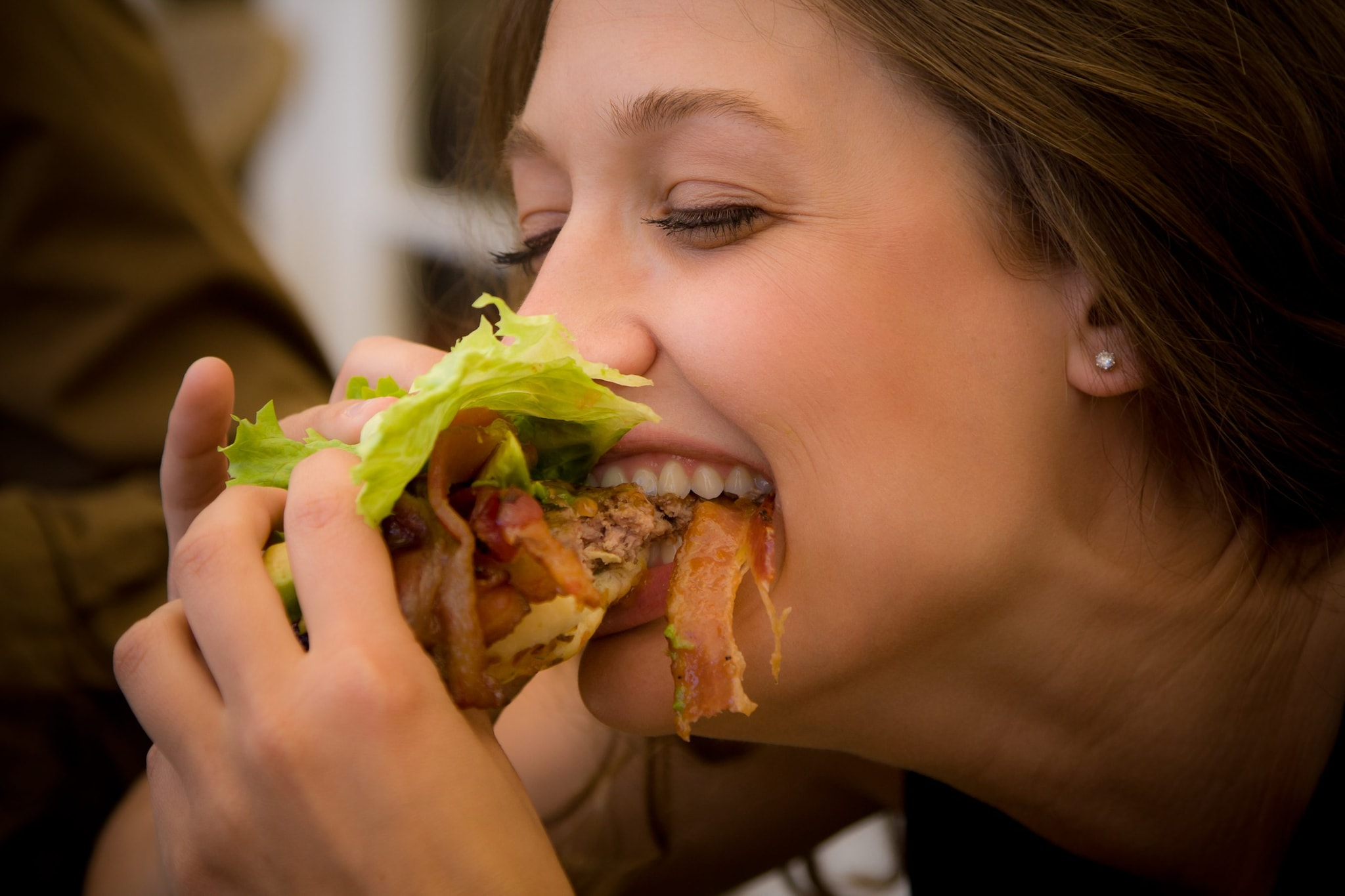 Woman mouth full food pictures