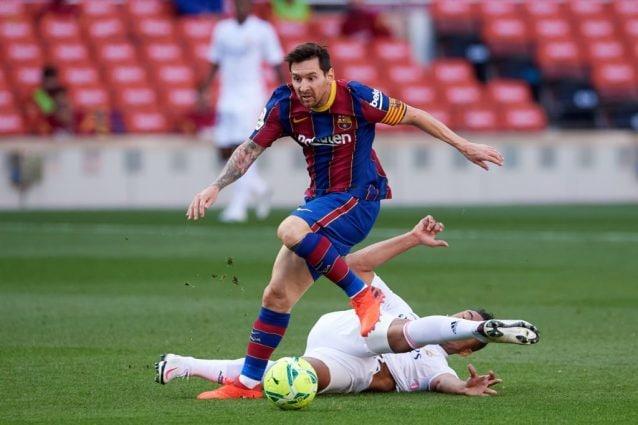 Leo Messi in azione contro il Real Madrid