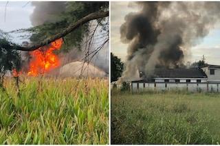 Incendio in un capannone a Vedano Olona: alta colonna di fumo nero, vigili del fuoco in azione