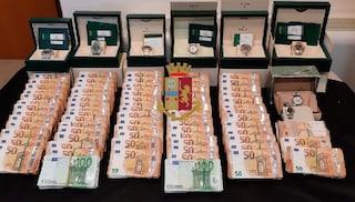Documenti falsi e un tesoro in casa: Rolex e 400mila euro in contanti