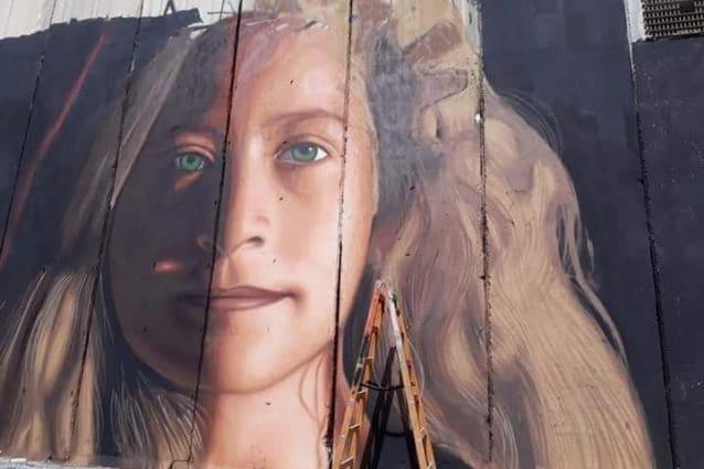 Il murales realizzato da Jorit a Betlemme.