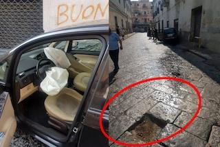 Secondigliano, lastra si solleva dal manto stradale: auto con bimba a bordo finisce contro il muro