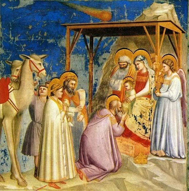 """Giotto, L'Adorazione dei Magi nella Cappella degli Scrovegni (Padova). La Cometa raffigurata è quella di Halley, al cui passaggio l'artista assistette nel 1301: probabilmente a partire a questo momento prevalse nella tradizione e nell'iconografia la dicitura """"cometa"""" per indicare la Stella di Betlemme"""