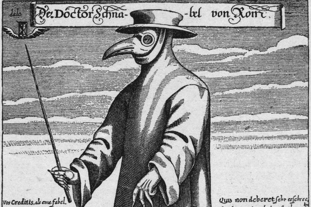 Un medico abbigliato per il trattamento dei malati di peste