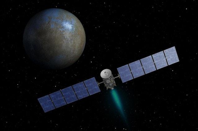 Rappresentazione artistica della sonda Dawn con il pianeta nano Cerere