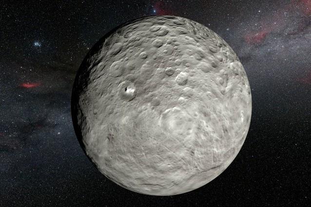 Rappresentazione artistica di Cerere sulla base delle informazioni raccolte dalla sonda Dawn della NASA. Visibile, più chiaro, il cratere Occator con la macchia luminosa (Crediti:ESO/L.Calçada/NASA/JPL–Caltech/UCLA/MPS/DLR/IDA/Steve Albers/N. Risinger)