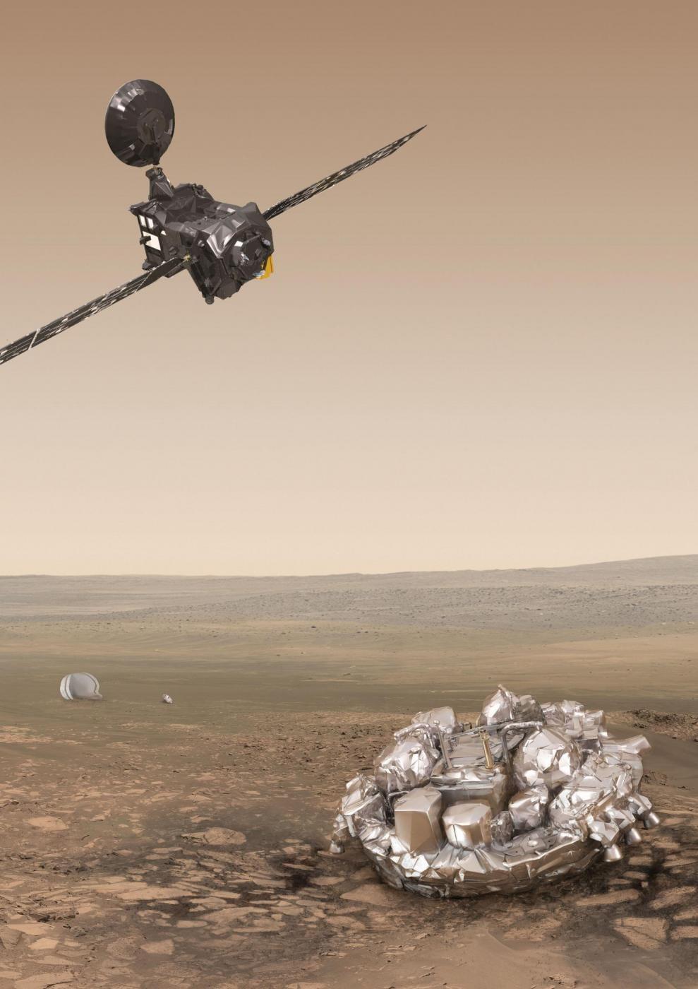 Il Trace Gas Orbiter, in alto, e Schiaparelli, sul suolo, in una rappresentazione artistica del momento dopo la sua discesa controllata con il paracadute. (AOES Medialab/ESA/PA Wire)