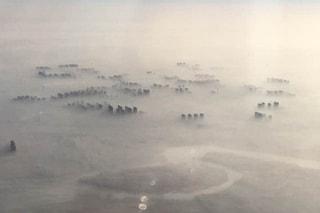 Cina, inquietanti immagini delle città coperte dallo smog, ma va molto meglio del 2013