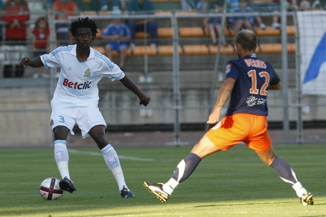 FOOTBALL - FRIENDLY GAMES 2011/2012 - OLYMPIQUE MARSEILLE v MONTPELLIER HSC - 15/07/2011 - PHOTO PHILIPPE LAURENSON / DPPI - NICOLAS N'KOULOU (OM) / GEOFFREY DERNIS (MON)